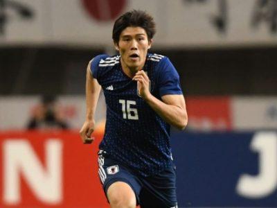 Takehiro Tomiyasu in azione con la maglia del Giappone